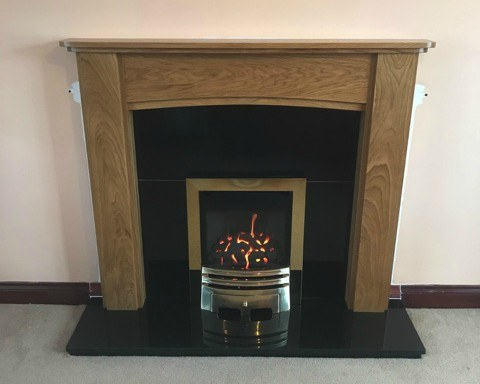 Solid Oak Mantelpiece with Polished Black Granite and Inset Balanced Flue Gas Fire