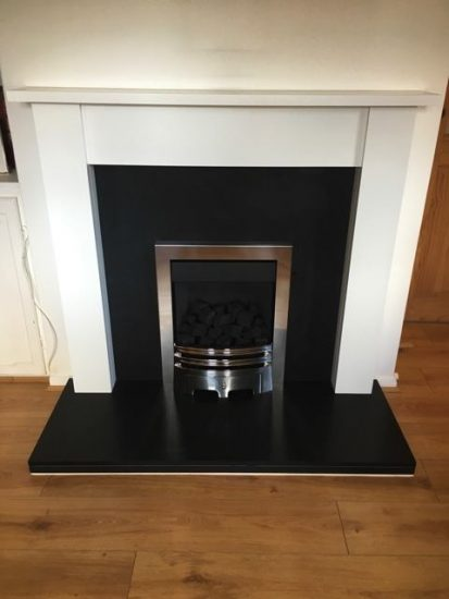 Contemporary White Painted Mantelpiece with Honed Black Granite and Inset Gas Fire