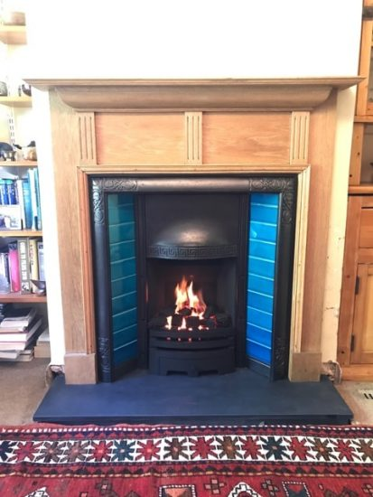 Refurbished Period Fireplace with Black Slate Hearth and Decorative Gas Fire